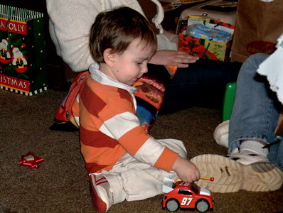Ethan plays with his new toy car. Christmas at Norma's, 2006.