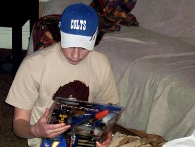 Jake checks out his new rocket. Christmas at Norma's, 2005.