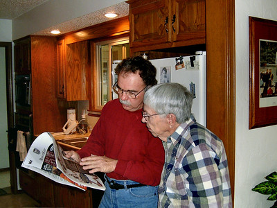 Larry and Mrs Russell check the scores. Thanksgiving at Cara's, 2005.
