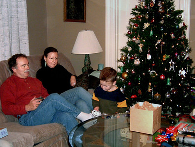 Larry and Rita watch Wes playing with his new toys. Christmas at Norma's, 2005.