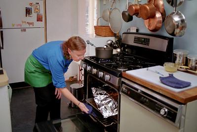 Rita checks the Thanksgiving turkey in her kitchen on W. Mount Vernon Street. November, 2007.