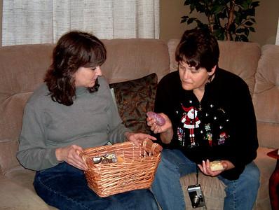 Dana looks at Cara's home made soap. Christmas at Norma's, 2005.