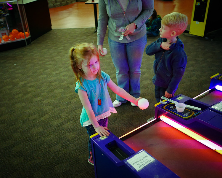 Logan's 5th Birthday Party Layla was just starting to get the hang of Skee Ball.