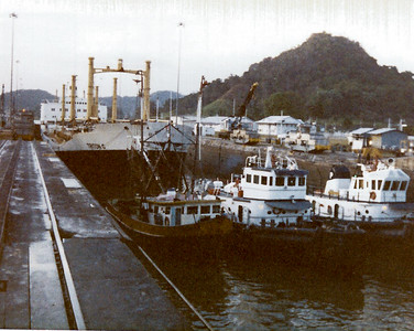 Tugs pulling ship through Panama Canal locks