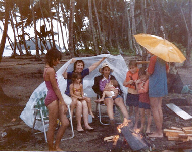 Carrie, Grandma, Aimee, Tiffany, Matthew, Marc and Michael trying to get out of the rain on Isla Mame 1983