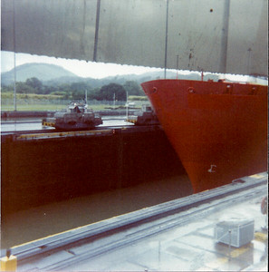 Mules pulling ship through locks of Panama Canal