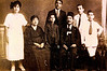 Famille Elias Baddour, de Gauche a Droite:  Marie, Gamila, Jean, Albert (derriere), Elias, Edouard, Emile.  Circa 1923.