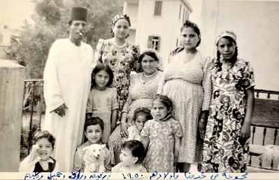 Bottom row: Rafik, Gamil, Raouf.  Avec tous les domestiques. 1950.
