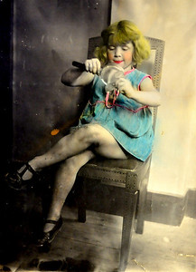 Ima. (I think this is a hand coloured black and white photo.  The early days of photoshop.  Guessing mid to late 1920s.)