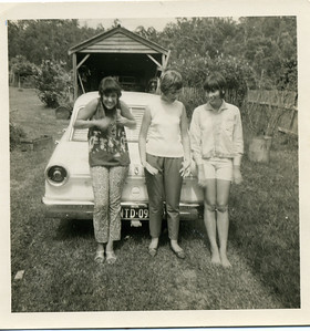 This was taken in our back yard at Mudgeeraba in January 1968.  The old shed is still standing - well only just standing - these days it slopes a little to the left. From Left to Right - my sister Garland, cousin Doreen Donges and other sister Judith  Photo from my mothers collection, Moira Bray