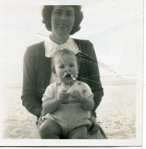 Unfortunately badly scratched - but this is my mum Moira Bray with my sister Garland on her knee - 1955.  Photo from my mothers collection, Moira Bray