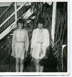 Garland Bray with her school friend Heather Reiser standing at the front of our home at Mudgeeraba in 1966 - unfortunately Garland was caught with her eyes shut. The uniform the girls have on was the Mudgeeraba State School sports uniform.  Photo from my mothers collection, Moira Bray