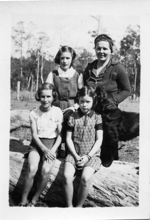 Sarah Tinney (Sally) (nee Tolson) and her girls with Patch the dog. Ruth Tinney is the girl standing beside her mother. Her sisters Eileen & Dorothy are sitting on the log (have no idea which is which). Photo taken 15 Sep 1941  Photo from my Grandmother's Collection - May McGilvery