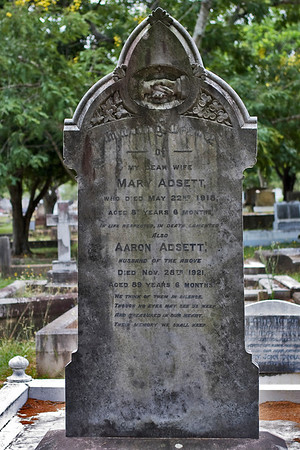 """Lutwyche Cemetery, Brisbane - Headstone in memory of pioneers Aaron Adsett & Mary Adsett (nee Maddock)  Mary (1836-1918) was born in Callington, Cornwall and is the daughter of Thomas Maddock & Mary Stevens (Stephens) She arrived in Moreton Bay aboard the 'Artemisia"""" in December 1848.  Aaron (1832-1921 was born in Ewell, Surrey and is the son of John Adsett & Anna Amelia Kitchenside. He arrived in Moreton Bay aboard the 'Duchess of Northumberland' in February 1851.  Inscription:  In loving memory of My dear wife Mary Adsett Who died May 22nd 1918 Aged 81 years 6 months In life respected, in death lamented Also Aaron Adsett Husband of the above Died Nov 28th 1921 Aged 89 years 6 months  We think of them in silence, Though no eyes may see us weep, And treasured in our heart, Their memory we shall keep.  Click on the photo to enlarge it and read the inscription.  Photo taken by Lesley Bray January 2009."""