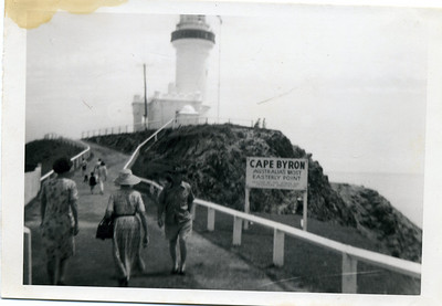 Who is this -  I don't know Obviously taken at Byron Bay Lighthouse, Australia's most easterly point. I'm guessing that is my grandmother with the hat and the handbag beginning her walk up to the lighthouse.  Guessing that is Beryl McGilvery on the left walking with Gran  Photo from my grandmother's collection - May McGilvery (nee Munro).
