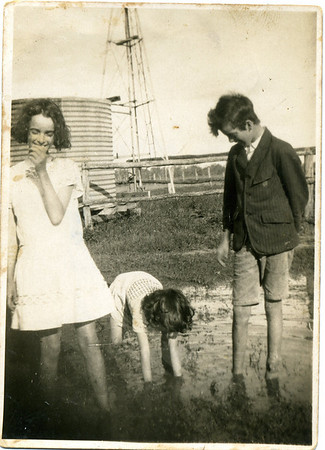 I love this one - that is my mother bending over and playing in the water - in the early 1930's. From left to right - May McGilvery, Moira McGilvery and Tom McGilvery  Inscribed  (in pencil writing ) - 'You! You! I'm shy! Later over inscribed in pen - 'With May & Tom -Bunya Mountain Road, Kaimkillenbun c early 1930's'  Photo from my grandmother's collection - May McGilvery (nee Munro).