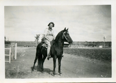 Nell wrote on the back of this photo - 'This is me on the black pony when I was fatter.  I like the way the pony is standing'.  Photo from my grandmother's collection - May McGilvery (nee Munro)