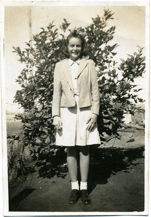 Betty English  Her mother Nell wrote on the back of the photo - This is Betty, she is a big help now, she can make most of her own clothes if I cut them out & she is a very good worker & does well at school.  She is sitting for her scholarship next year.  Photo from my grandmother's collection - May McGilvery (nee Munro)