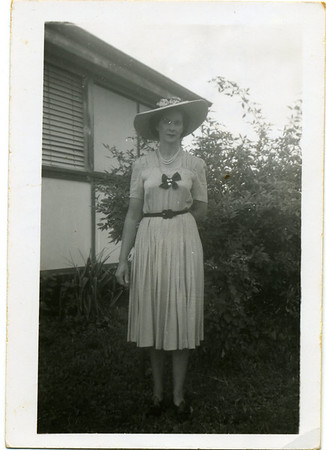 Nell Curd  Nell has written on the back of the photo - ' I am too serious in this snap, the dress I have on is one I made myself.  It's got unpressed pleats in the skirt.  The pearls & the heart locket is what Chas gave me.'  Photo from my grandmother's collection - May McGilvery (nee Munro)