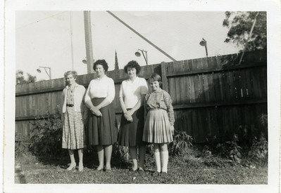 I love this photo - it was taken at the home of my aunty May Alroy (nee McGilvery) - in her backyard - I am guessing around 1967.  From left to right - my grandmother, May McGilvery (nee Munro) (1895-1992); Gran's eldest daughter Nell Curd (nee McGilvery); Nell's daughter, Betty Donges (nee English)(1934-1999); and Betty's daughter Doreen Donges (later McPhail).  Photo from my grandmother's collection - May McGilvery (nee Munro)