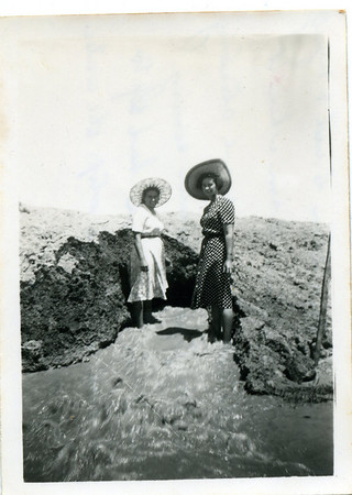 Nell Curd (nee McGilvery) with her sister-in-law   Nell has written on the back of the photo - 'This is Mrs Stan Curd & myself up at Stans Dam when it broke its bank.  We are standing in the flow of water coming out of the dam.  We had to fill that hole to stop the water getting away.'  Photo from my grandmother's collection - May McGilvery (nee Munro)