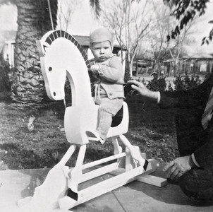 Phil on rocking horse 12/1943. The rocking horse was a Christmas present.