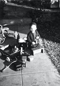 """""""That little bench and hammer was his favorite toy, but now that he can ride the tricycle he likes that best."""""""