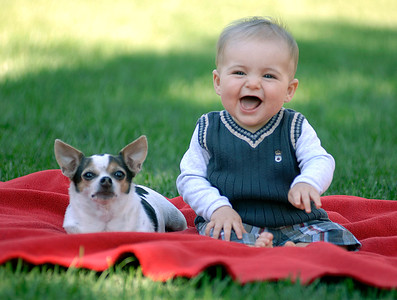 baby and dog on a blanket