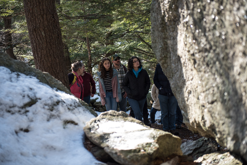 . (01/21/18 PRINCETON MA) Hikers admire what is called the Glacial Boulder inside the Wachusett Meadow Wildlife Sanctuary in Princeton during a family nature hike on Sunday.  SENTINEL & ENTERPRISE JEFF PORTER
