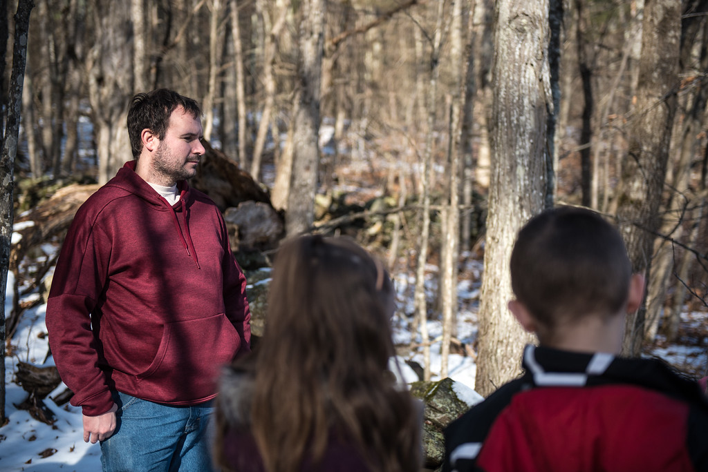 . (01/21/18 PRINCETON MA) Sentinel & Enterprise reporter Nick Mallard listens to the tour guide during a nature walk on Sunday at the Wachusett Meadow Wildlife Sanctuary in Princeton.  SENTINEL & ENTERPRISE JEFF PORTER