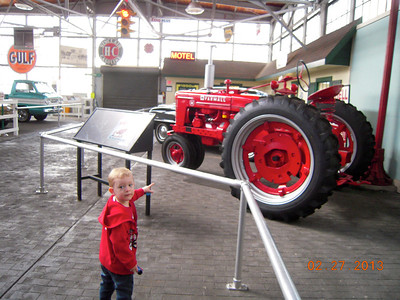 JD pointing at his favorite tractor