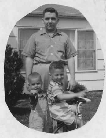 Jim Lacey III with sons Frank and Jim (on Bike) at our apartment home in Ft. Wayne IN Circa 1960.  Jim was working for Magnavox on Navy projects.