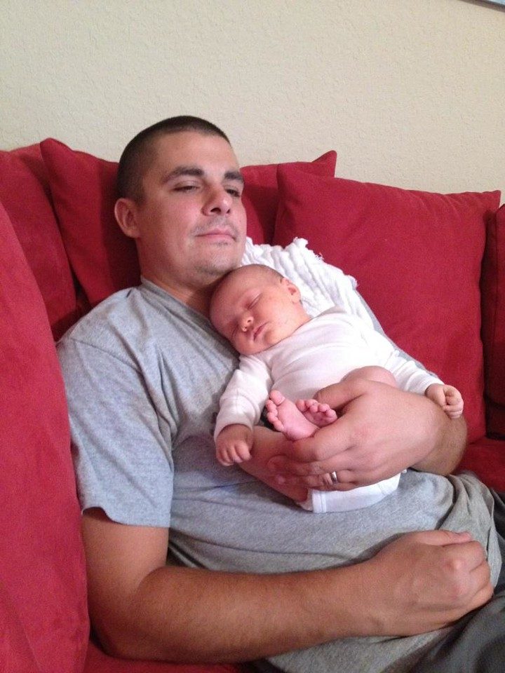 Great-grandson Cyrus Harvey Lacey watching TV with his  father Rory Lacey - grandson of Jim and Mary Lacey. Cy was born 08/20/2012.