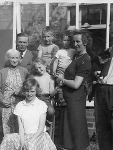 Little Grandma, Uncle Arthur, Jenny, Elizabeth, Bill (5), Peter (2), Auntie Muriel, Tony and John (35) House in Bristol 1955