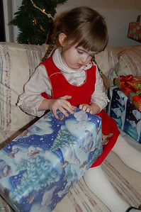 "Ainsley opened all of her presents (of course) and ""helped"" everyone else open all of their presents, too."