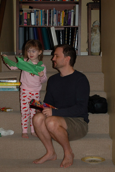 Helping dada with his stocking.