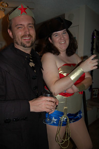 You know it's a good party when the French highwayman and Wonder Woman start exchanging parts of their costumes.