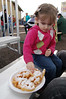 Ainsley's first encounter with funnel cake.  Hmmm.  What is this thing?
