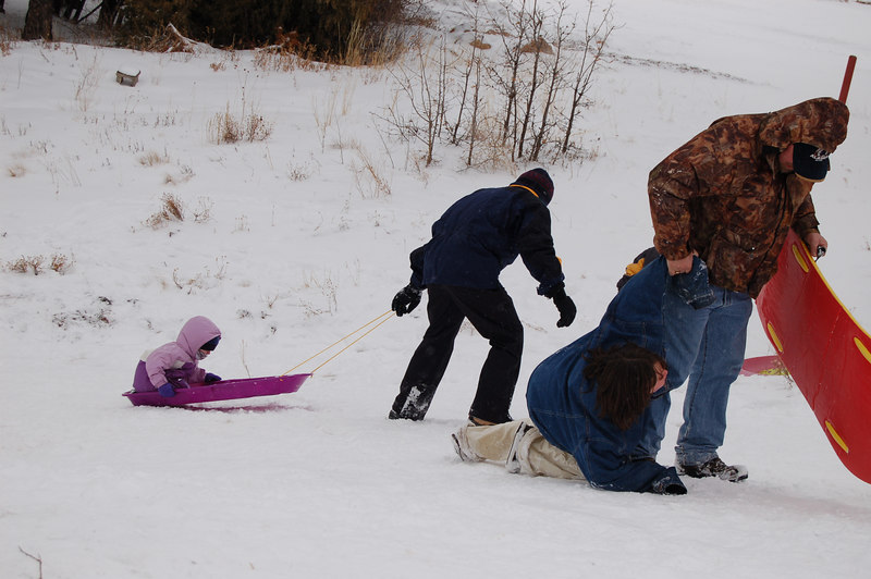Ainsley's first sledding expedition!  It was as much fun to be dragged up the hill as it was to slide down.  Maybe more.