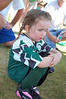 Ainsley's first soccer game.  It was wickedly hot--well over 100 degrees--and there was almost no shade.  It didn't help that almost every square inch of her skin was covered in voluminous forest green and black clothes.