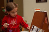 Decorating a gingerbread house for Grandma.