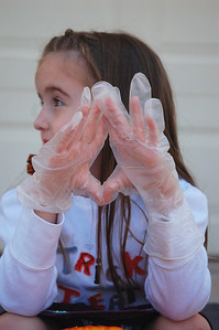 """Ainsley asked for gloves to protect her from the """"pumpkin eew.""""  Luckily, I had some in my cake decorating supplies."""