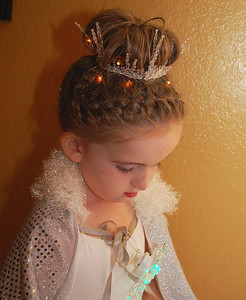 The Snow Queen's sparkly, glowy, icy crown.  There's a battery pack and miniature Christmas lights hidden under all that hair.