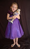 Ainsley thought she looked like Clara in her purple dress, with her purple nutcracker.