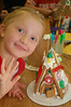 Ainsley's friend Summer showing off her gingerbread house.