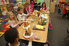 I made gingerbread houses for each kid in Ainsley's kindergarten class.  We had a ton of fun decorating them last Friday.