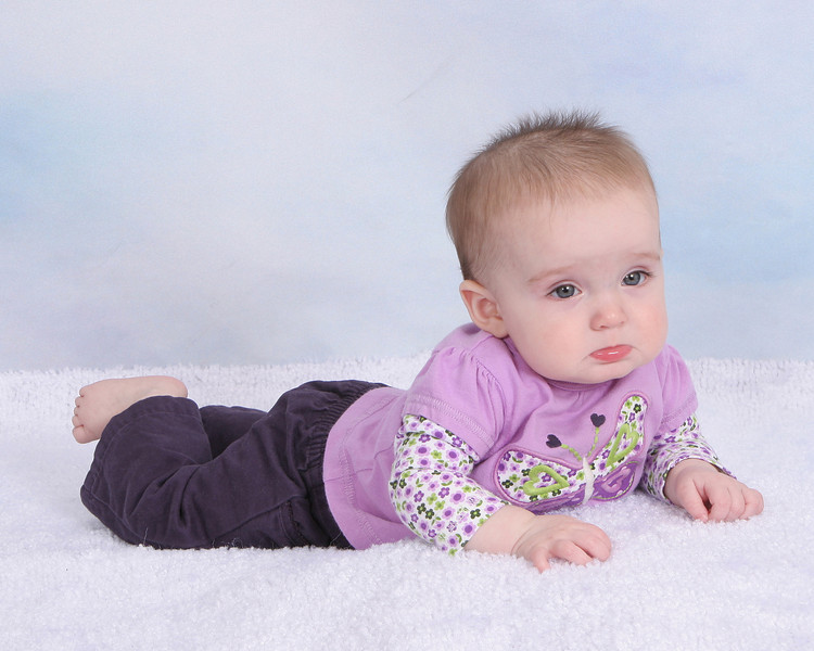 Six month old portraits.  She was a little grumpy today.
