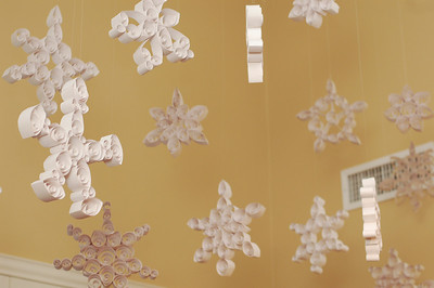 I hung LARGE quilled snowflakes from the ceiling, creating a gorgeous winter installation.  All of the snowflakes only cost me $2.19 to make.