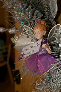 A wreath with a tinly plum fairy bearing a birthday wish greeted guests at the door.