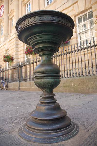 "One of four brass ""nails"" (bar table height) outside of the corn exchange in Bristol.  The merchants used to sign their deals on these nails, which brought rise to the phrase ""Pay on the nail."""